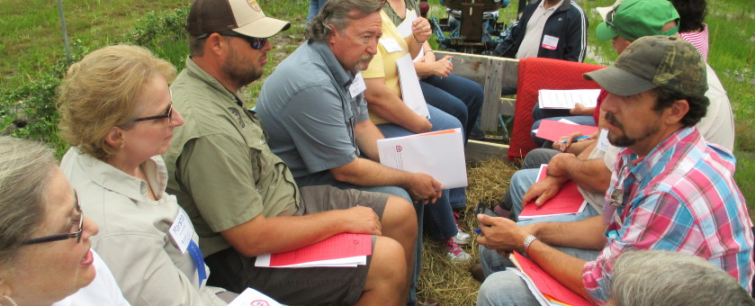 Steve Anderson (center), owner of Myrtle Creek Farms, prepares participants for a hay ride and mock safety inspection